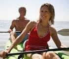 happy fit couple canoeing
